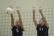 Seabury Academy's Jessica Babcock, left, and Calli Noller go up for a block. Seabury lost the match to Flint Hills Christian in three games Thursday at Seabury.