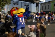 """Get Downtown"" brought Kansas University fans and Baby Jay to a street party on Eighth Street between Massachusetts and New Hampshire. The road was closed to traffic Friday evening as fans celebrated with food, drink and music. The KU football team takes on Toledo at 6 p.m. today at Memorial Stadium."