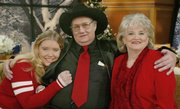 "Andrew Jackson ""Jack&squot;&squot; Whittaker Jr., his wife, Jewell, and their granddaughter, Brandi Bragg, pose for a photo after being interviewed on NBC&squot;s ""Today"" show in this December 2002 file photo in New York. Whittaker sometimes wonders if winning the nearly $315 million Powerball game was worth it. After winning the jackpot, his wife left him and his granddaughter died."