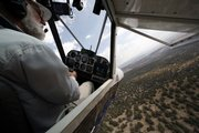 John Morgan flies his plane Wednesday in Minden, Nev. Morgan is one of many searching the area for missing aviator Steve Fossett. After finding a half-dozen old airplane wrecks, crews searching for Fossett focused on new tips about planes actually flying in the area the day his disappeared.