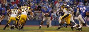 Kansas' Brandon McAnderson finds a hole against Toledo on Saturday at Memorial Stadium.