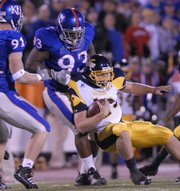Kansas University defensive lineman James McClinton (93) drags down Toledo quarterback Aaron Opelt. McClinton, undersized for a Big 12 Conference defensive tackle, has made his presence felt this season with his quickness and surprising strength.