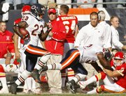 Chicago's Devin Hester (23) runs back a 73-yard punt return for a touchdown during the second quarter of the Bears' 20-10 victory over the Kansas City Chiefs.