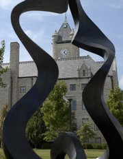 """The Douglas County Courthouse is framed by the sculpture """"Introspection (8)"""" by Larry Young, of Columbia, Mo. The first phase of a multiyear historic preservation effort will begin next month at the 102-year-old Douglas County Courthouse."""