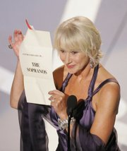 "Presenter Helen Mirren holds up the envelope showing that ""The Sopranos"" won for outstanding drama series at the 59th Primetime Emmy Awards on Sunday at the Shrine Auditorium in Los Angeles."