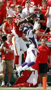 Kansas City Chiefs wide receiver Dwayne Bowe, left, pulls down a pass over Minnesota's Cedric Griffin for a fourth-quarter touchdown reception. The TD lifted the Chiefs to a 13-10 victory Sunday at Arrowhead Stadium.