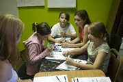 A group of girls study the history behind Sukkot. They are, from left, Joanna Lepley, 10 (in hooded sweatshirt), Rachel Hurt, 10, Annarose Lepley, 12, and Jessica Hurst, 10, all of Lawrence.