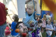 Jason Ptaszek, bottom, supports five-year-old Luke Gottschamer on his shoulders Sunday, Sept. 23, 2007 while decorating for the Jewish holiday Sukkot at the Lawrence Jewish Community Center, 917 Highland Dr.