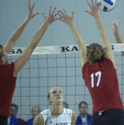 Senior outside hitter Emily Brown watches as two Cornhuskers control the net during the KU home volleyball match versus No. 1 Nebraska. NU swept KU, 3-0, Wednesday at Horejsi Center.