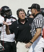 Texas Tech coach Mike Leach talks with an official in the second quarter of the Red Raiders' loss to Oklahoma State on Saturday in Stillwater, Okla. Leach has had a few notable rants to the press during his Tech tenure.