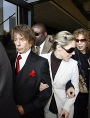 Music producer Phil Spector and his wife, Rachelle Spector, walk out of Los Angeles Superior Court. Spector's trial on murder charges ended in a mistrial Wednesday because of a deadlocked jury.
