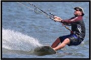 Sean Beaver, president of Kansas City Kite Club and veteran kiteboarder, shows how it's done at Clinton Lake. Beaver brought the extreme sport to the Midwest from Hawaii, where he learned it on vacation six years ago.