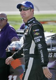 NASCAR driver Clint Bowyer sports a Kansas University hat before qualifying for the LifeLock 400. Bowyer will start 10th on Sunday.