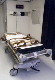 Florida's lethal injection gurney is shown in an undated handout photo taken in the redesigned death chamber that will accommodate either the electric chair or the gurney at Florida State Prison. Lethal injections were supposed to be the humane way to execute inmates and avoid the excruciating pain caused by firing squads, electric chairs and the hangman's noose. But many still argue the chemical cocktail amounts to cruel and unusual punishment.