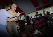 "Nancy Landis, and her father, Edmund Mechavich, both of Oskaloosa, dance the schottische Saturday, Sept. 29, 2007 at the St. John the Evangelist Catholic Church Oktoberfest. ""I&squot;ve been waiting for 20 years to dance the schottische with him,"" she said."