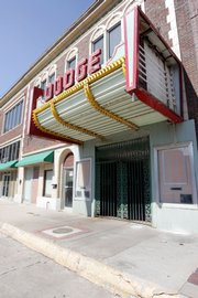 "The Dodge Theater is chained shut Monday  in Dodge City. Despite efforts to revitalize the theater, it stands remodeled, but vacant, after the owners spent $200,000 renovating the building, which was built and opened in 1929. The world premiere of the 1939 movie ""Dodge City"" took place at the Dodge Theater."