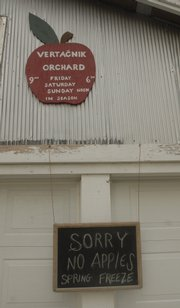 A sign hangs outside of Vertacnik's Orchard east of Lawrence that tells the plight of most apple growers in the area.