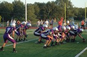 The Baldwin High football team lines up in the single wing offensive formation during a recent game. Zach Dur (7) is the wing back, Drew Berg, center, is the blocking back and Sam Beecher and Jared Hall are the tailback and fullback. Baldwin is averaging seven yards per carry this fall.