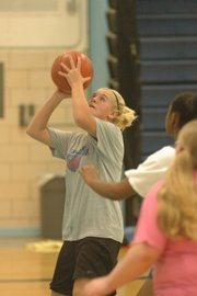 West freshman paige Rothwell takes a shot during the Warhawks' tryout session Tuesday at West Junior High. Rothwell, who was among 18 basketball hopefuls, just finished volleyball season Saturday.