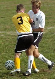 FSHS senior midfielder Andrew Heck, right, collides with Blue Valley senior Travis Brockmeyer on Thursday, Oct. 4, 2007 during the FSHS home soccer match.