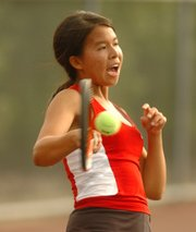 Lawrence High's Xin Liu hits a shot during the Class 6A regional tennis tournament Thursday at the Lawrence Tennis Center.