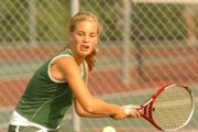 Free State's Jessica Wuthrich hits a return during the Class 6A regional tennis tournament Thursday at Lawrence Tennis Center.