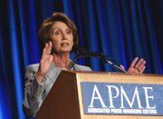 Speaker of the House Nancy Pelosi, D-Calif., addresses the annual meeting of the Associated Press Managing Editors in Washington. The House and the Senate will vote on bills that would shield reporters from revealing sources in some federal cases.