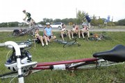 Octoginta riders lounge in the grass off of County Road 458 near Lone Star on Sunday, Oct. 7, 2007, at a breakfast stop along the ride. From left is James Ronnau, of Overland Park, Jud Jarett, of Lincoln, Neb., Keith Stewart, of Manhattan, Mike Lovin, of Atlanta, Georgia, and Andy Powell, of Long Beach, Calif. The group consists of KU alumni and has made the yearly migration back to Lawrence for the ride since 1984.