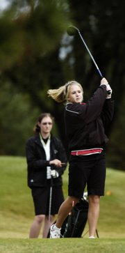 Lawrence High's Hilary Ferguson tees off on the second hole during the Class 6A regionals. Ferguson qualified for state as an individual Monday at Alvamar Golf Course.