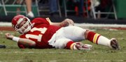 Chiefs quarterback Damon Huard tries to get to his feet after being knocked to the ground in the fourth quarter.