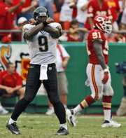 Jacksonville quarterback David Garrard (9) celebrates his three-yard touchdown pass to Dennis Northcutt as Kansas City's Tamba Hali walks off the field. The Jags won, 17-7, Sunday in Kansas City, Mo.