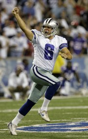 Dallas kicker Nick Folk celebrates his game-winning field goal. Folk's 53-yarder as time ran out gave the Cowboys a 25-24 victory over the Buffalo Bills on Monday in Orchard Park, N.Y.
