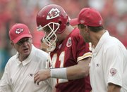Kansas City Chiefs quarterback Damon Huard, center, is assisted by the team's medical staff during the fourth quarter of the Chiefs' loss to Jacksonville. Huard's status for Sunday's game is unknown.