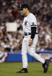 New York manager Joe Torre walks back to the bench after a trip to the mound. Torre likely coached his last game for the Yankees on Monday in New York.