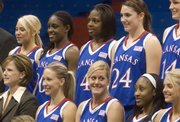 Marija Zinic (bottom center) jokes around with her teammates as they prepare for the official Kansas women's basketball team photo on Wednesday at Allen Fieldhouse. The Jayhawks met with the media to talk about the upcoming basketball season.