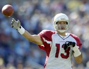 Arizona quarterback Kurt Warner tosses a pass during a Sept. 23 game against Baltimore. A season-ending injury to Matt Leinart makes Warner the starting quarterback for Sunday's game against Carolina.