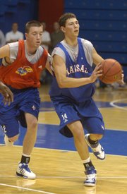 Rookie Tyrel Reed, right, passes under pressure from Brady Morningstar.