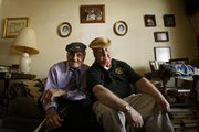"William Guarnere, left, and Edward Heffron huddle together in Philadelphia. The World War II veterans have written ""Brothers in Battle: Best of Friends,"" detailing their shared experiences."