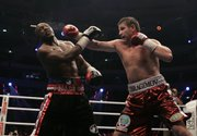 WBO heavyweight champion Sultan Ibragimov, right, sends a right to challenger Evander Holyfield during the title match. Ibragimov won a unanimous decision Saturday in Moscow.