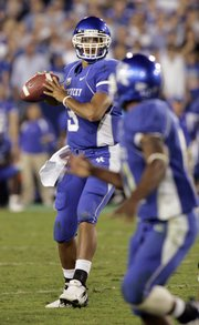 Kentucky quarterback Andre Woodson (3) looks for a receiver. Kentucky stunned No. 1 LSU in three overtimes Saturday in Lexington, Ky.