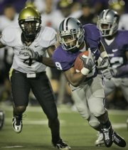 Kansas State running back Leon Patton (9) cuts past Colorado's Patrick Williams (4). The Wildcats routed the Buffaloes, 47-20, Saturday in Manhattan.