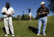 Golfers, from left, Brian Scherling, Overland Park; Michael Nicolotti, Lawrence; Ryan Wedel, Overland Park; and Dick Barton, Lawrence, prepare to tee off Thursday on hole one of Alvamar Country Club. Earlier this year, Alvamar hired a director of sales and marketing to help boost the club's membership.