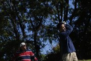Mike Reeves, left, watches as Jesse Nguyen, both of Lawrence, tees off Thursday, Oct. 11, 2007 on hole one of Alvamar Country Club.