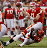 Kansas City quarterback Damon Huard (11) throws away the ball as he is tackled by Cincinnati safety Dexter Jackson. The Chiefs beat the Bengals, 27-20, Sunday in Kansas City, Mo.
