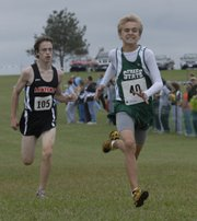 Free State's Logan Sloan, right, edges Lawrence High's Roy Wedge at the finish line. Sloan led the FSHS boys with an eighth-place finish, while Wedge was the first LHS boy to cross the line, in ninth place.