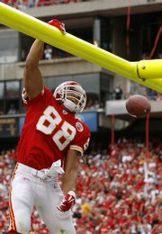 Kansas City tight end Tony Gonzalez celebrates after scoring a touchdown against Cincinnati. The TD Sunday in Kansas City set the NFL record for touchdown receptions by a tight end.