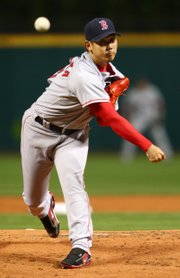 Boston's Daisuke Matsuzaka delivers against Cleveland.