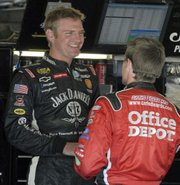 Clint Bowyer, left, talks with Carl Edwards during practice for the Bank of America 500. Bowyer, a Kansas native, took second in the race and has established himself as a dark horse contender for the Nextel Cup.