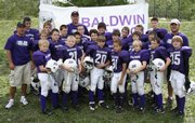 The sixth-grade Baldwin Bulldogs went undefeated and won a championship as fifth-graders in last year's Lawrence Youth Football league. This year the Bulldogs moved to the Kaw Valley League, but are on track for another undefeated season with a 7-0 record thus far.
