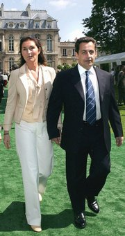 Nicolas Sarkozy and his wife Cecilia are shown in this July 14, 2004, file photo. The couple are separating by mutual consent after 11 years of marriage, the French president's office said Thursday. News of the couple's divorce overshadowed that of a 24-hour French transportation strike.